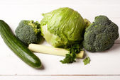 Green vegetables on white boards — Stock Photo