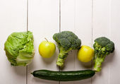 Green vegetables on white boards — Stockfoto
