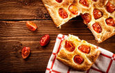 Focaccia with tomato and green olives. Retouching in retro style — Stock Photo
