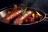 Grilled sausage with cherry tomatoes — Stock Photo