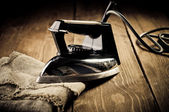 Old electric iron, touch-up in retro style — Stock Photo
