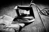 Old electric iron, touch-up in retro style. Black and White Phot — Stock Photo
