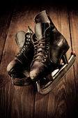 Old skates. Retouching in vintage style. — Стоковое фото