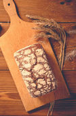 Bread on wooden boards, touch-up in retro style — Stock Photo