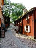 Red cabins in Skansen park — Stock Photo
