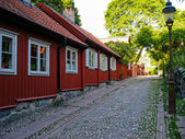 Red wooden swedish house — Stock Photo