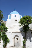 Church and orange tree on Paros island — Stock Photo