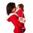 Mother and Baby both as santa smiling to each other — Stock Photo