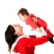 Mom holding her baby both dressed as Santa — Stock Photo #16269587