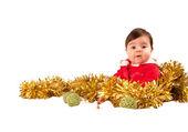 Surprised baby dress as santa looking at camera — Stock Photo