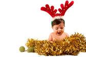 Baby mit offenem Mund Kleid als Rentier Blick auf Goldene Lametta — Stockfoto