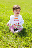 Cute baby on the grass smiling — Stock Photo