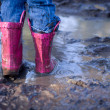 Mud puddle fun - Stock Photo