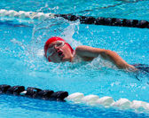 Boy swimming freestyle — Stock Photo