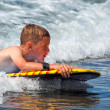 Stock Photo: Child riding waves