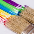 Paintbrushes painting rainbow colors — Stok fotoğraf