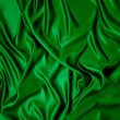 Green silk cloth with folds. — Stock Photo