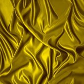 Yellow silk cloth with folds. — Stockfoto