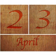 Stock Photo: Wooden calendar April 23.