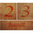 Stock Photo: Wooden calendar August 23.