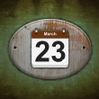 Old wooden calendar with March 23. — Stock Photo