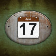 Old wooden calendar with April 17. — Stock Photo