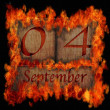 Stock Photo: Burning wooden calendar September 4.