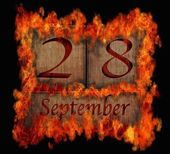 Burning wooden calendar September 28. — Stock Photo