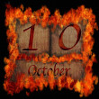 Burning wooden calendar October 10. — Stock Photo