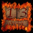 Burning wooden calendar October 13. — Stock Photo