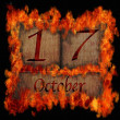 Burning wooden calendar October 17. — Stock Photo