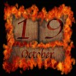 Burning wooden calendar October 19. — Stock Photo