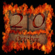 Burning wooden calendar October 20. — Stock Photo
