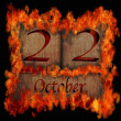 Burning wooden calendar October 22. — Stock Photo