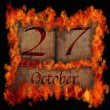 Burning wooden calendar October 27. — Stock Photo