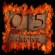 Burning wooden calendar October 5. — Stock Photo