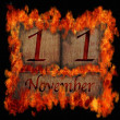 Stock Photo: Burning wooden calendar November 11.
