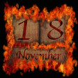 Burning wooden calendar November 18. — Stock Photo