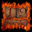 Burning wooden calendar November 19. — Stock Photo