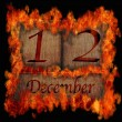 Burning wooden calendar December 12. — Stock Photo