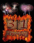 Burning wooden calendar December 31. — Stock Photo