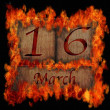 Burning wooden calendar March 16. — Stock Photo
