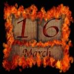 Burning wooden calendar March 16. — Stock Photo