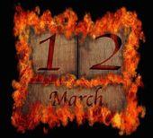 Brandende houten kalender 12 maart. — Stockfoto