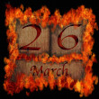 Burning wooden calendar March 26. — Stock Photo