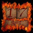 Burning wooden calendar April 17. — Stock Photo