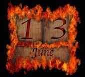 Burning wooden calendar June 13. — Stock Photo