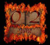 Burning wooden calendar June 2. — Stock fotografie