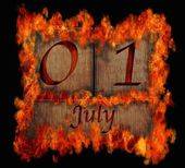 Burning wooden calendar July 1. — Stock Photo