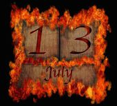 Burning wooden calendar July 13. — Stock Photo